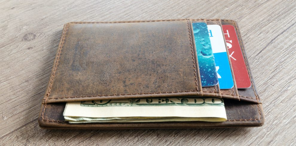 brown-leather-wallet-and-us-dollar-banknote-915915